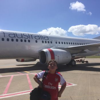 Kid in front of Virgin Airlines
